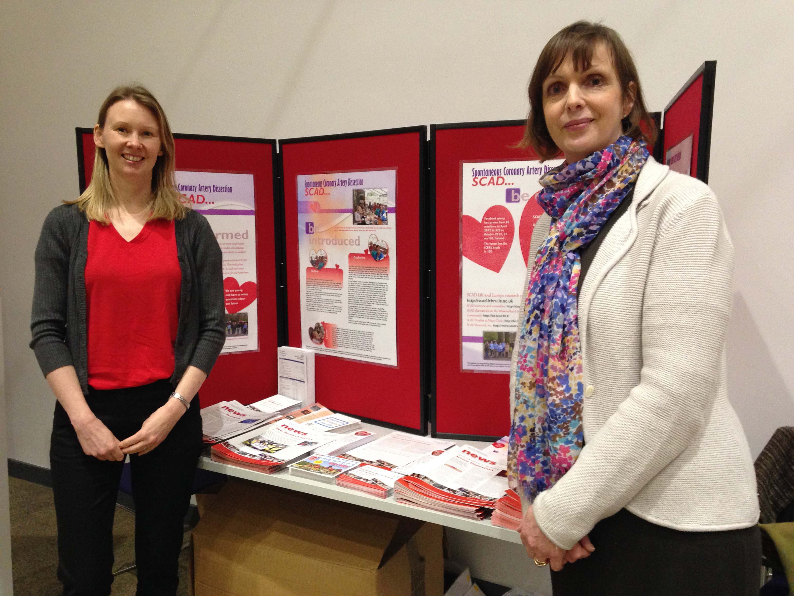 Rebecca Breslin (left) and Catherine Beck at the LCBRU stand that featured posters and leaflets designed by SCAD patients