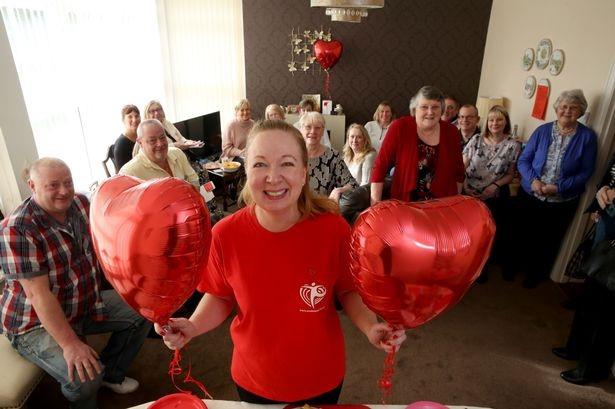 Paula raises £500 at Scones for SCAD event