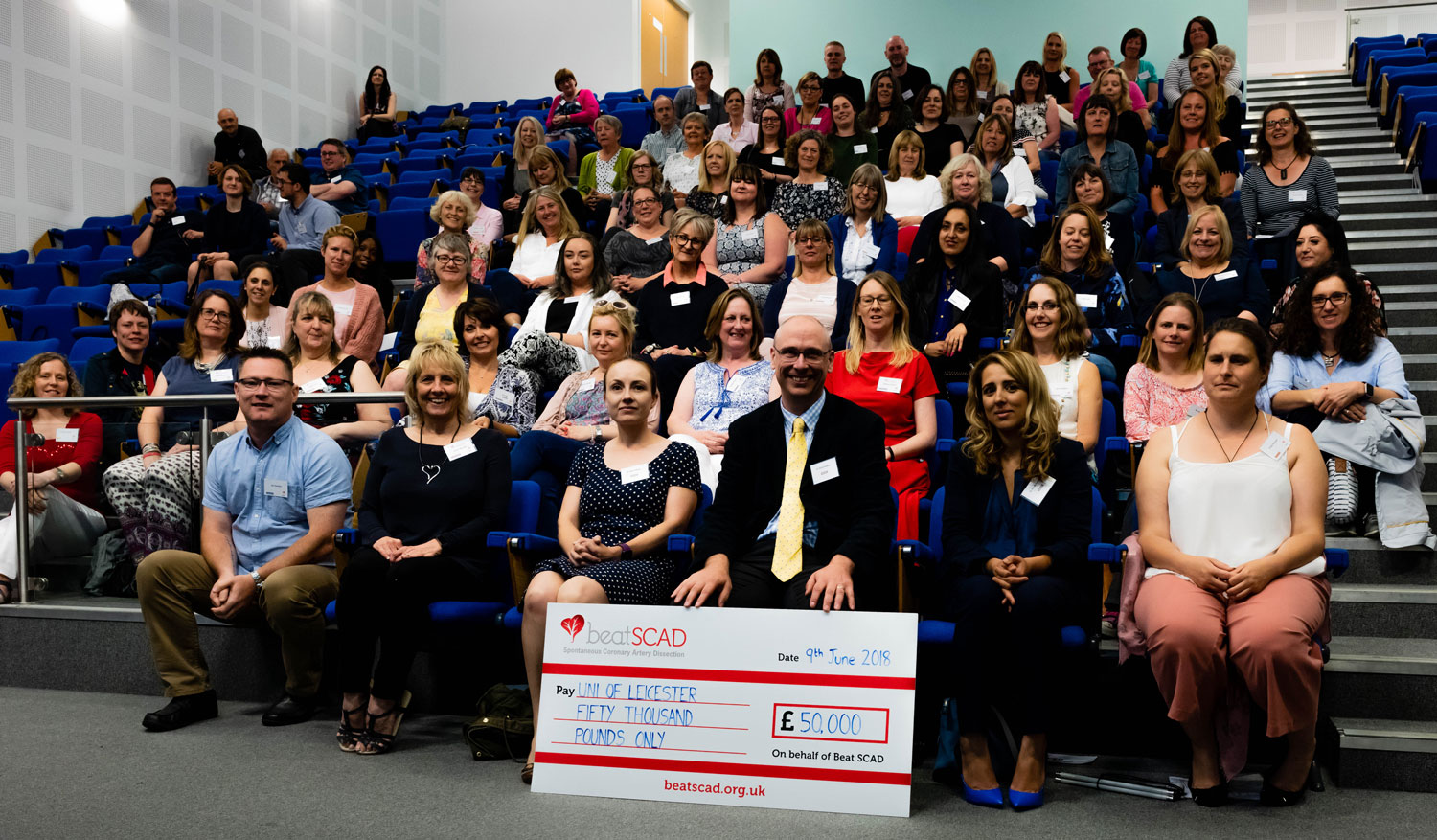 Conference delegates with cheque
